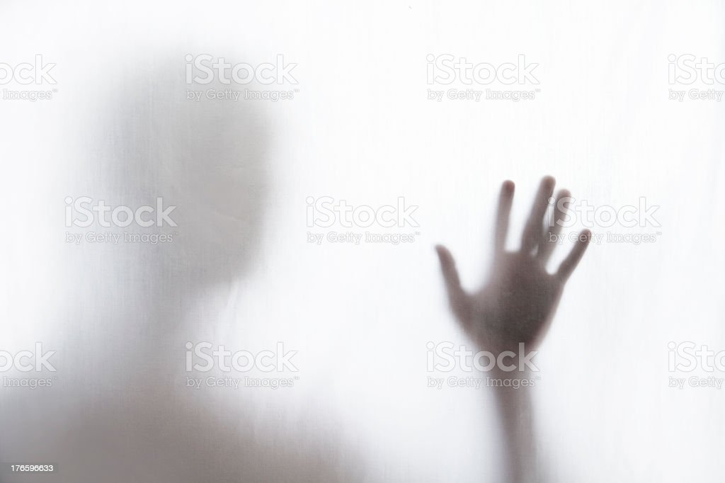 Shadow of man standing behind thin fabric royalty-free stock photo