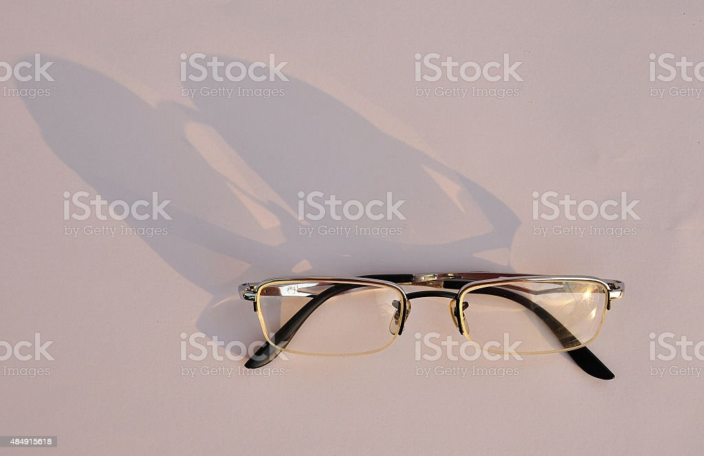 Shadow of old glasses stock photo