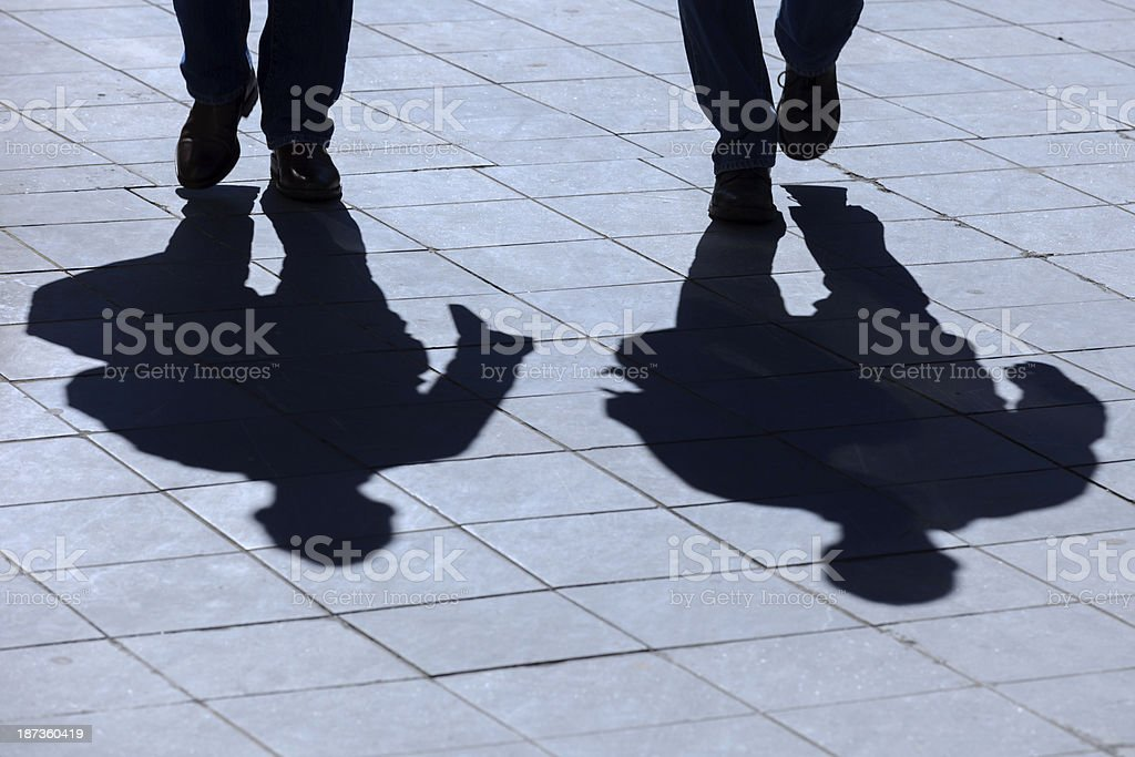 shadow of people walking on the street royalty-free stock photo