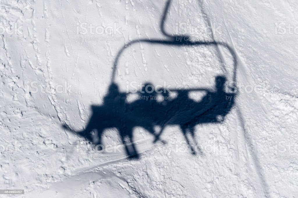 Shadow of Skiiers on Lift Chair stock photo