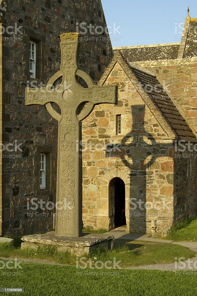 Shadow of the celtic cross royalty-free stock photo