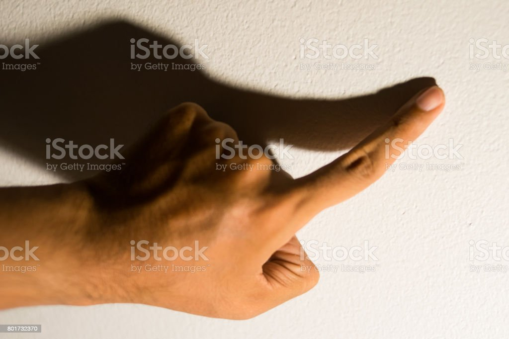 Shadow of the hand and fingers stock photo