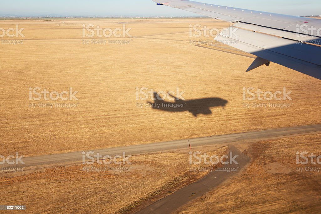 Shadow of the Landing Airplane stock photo