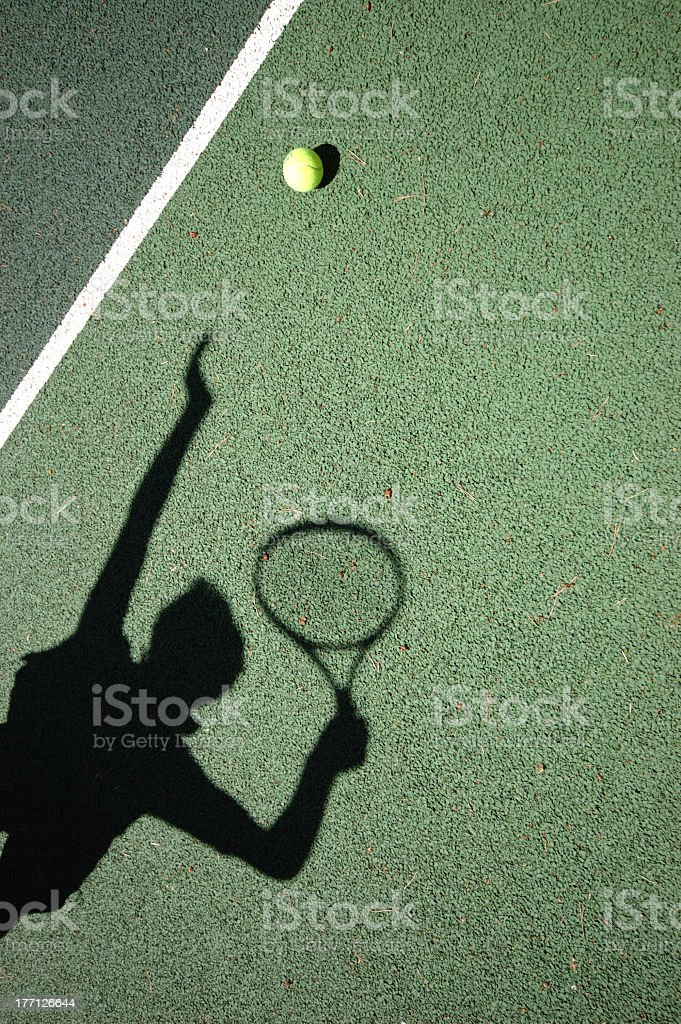 Shadow of the tennis serve on green floor royalty-free stock photo