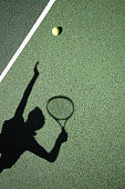 Shadow of the tennis serve on green floor