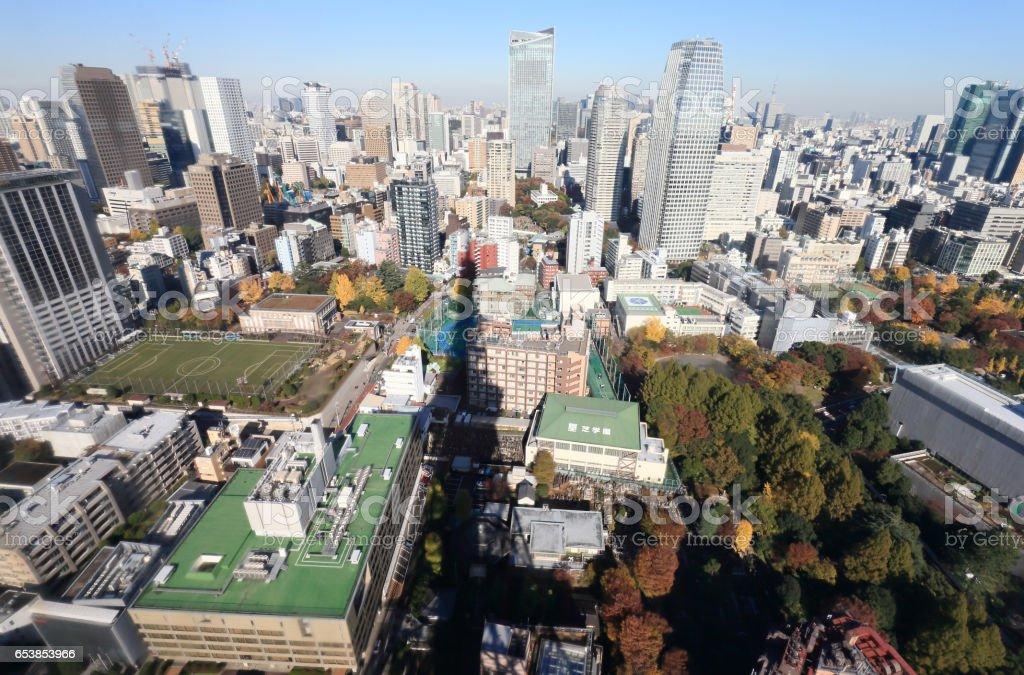 Shadow of Tokyo tower on buildings stock photo