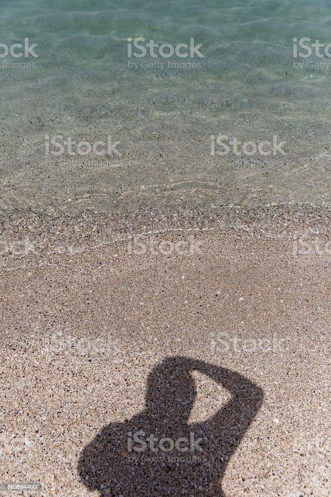 Shadow of Tourist Taking Photo stock photo