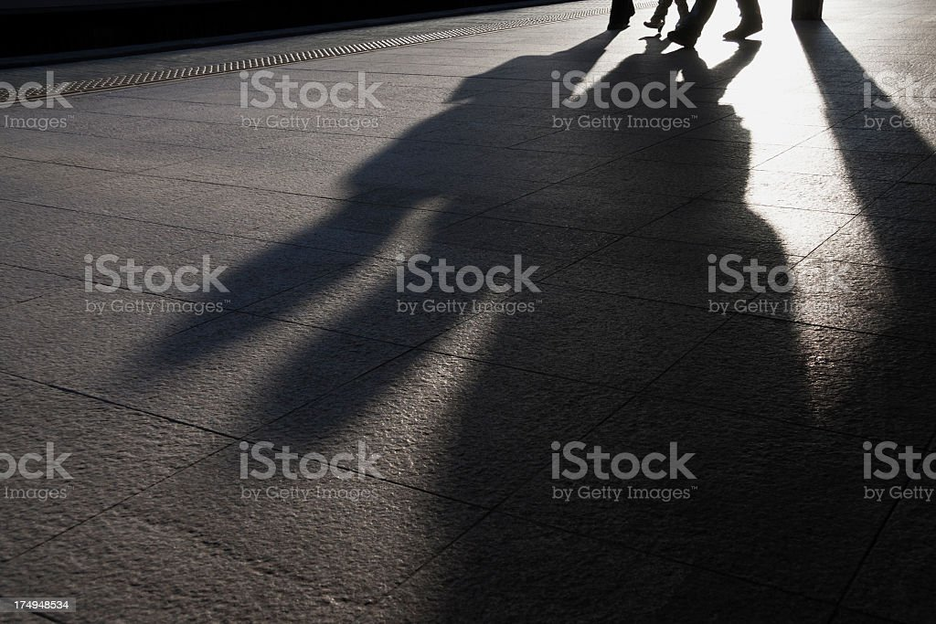 Shadow of two businessmen. stock photo