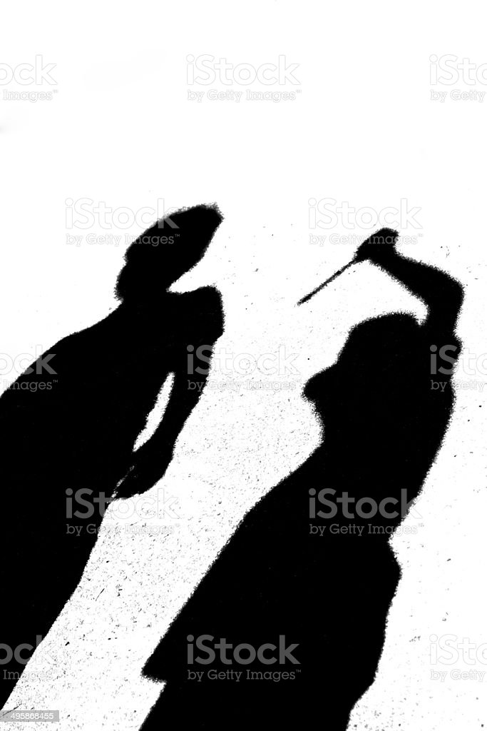Shadow of two people one with knife-murder, copy space royalty-free stock photo