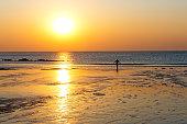 shadow of woman practicing at seashore