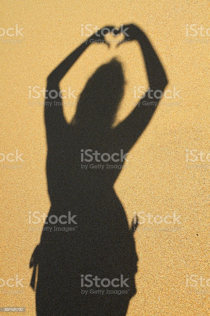 Shadow on the sand stock photo