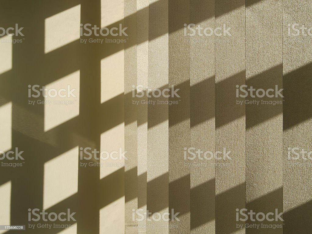 Shadow pattern on window blind and wall stock photo