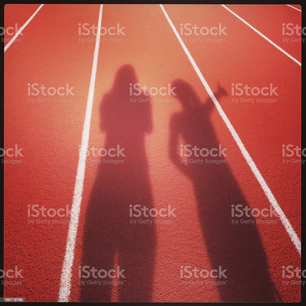 Shadow People on Running Track royalty-free stock photo
