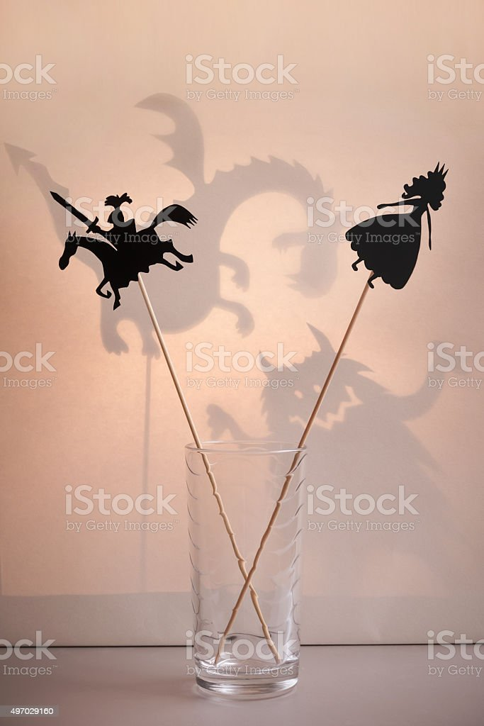 Shadow puppets in the glass stock photo