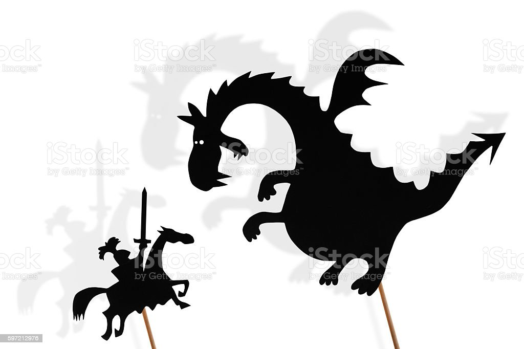 Shadow puppets of dragon and knight stock photo