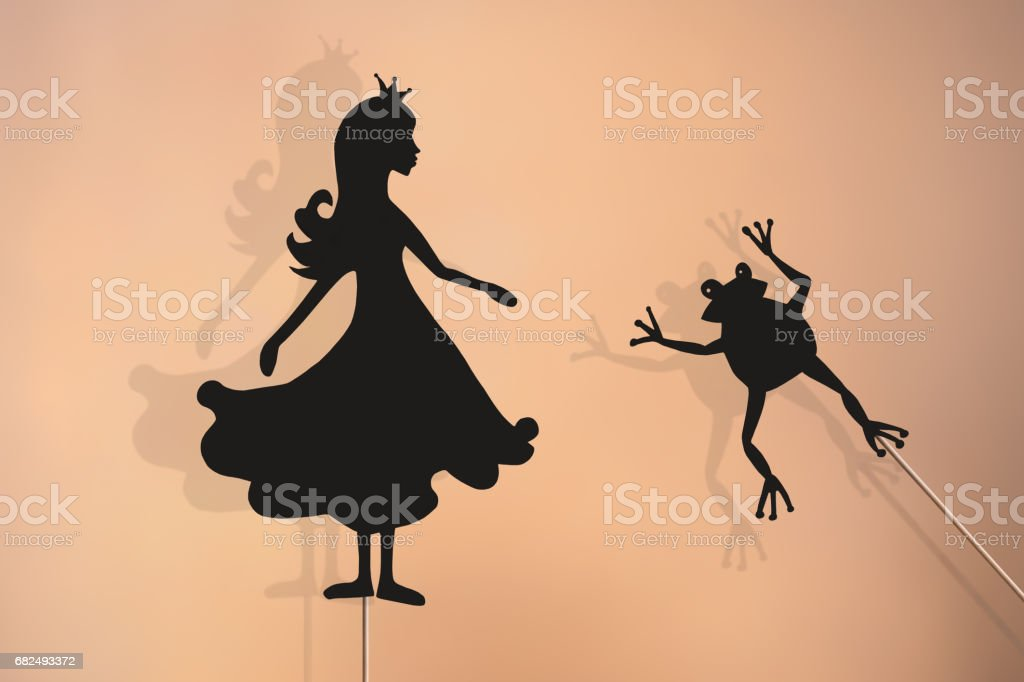 Shadow puppets of Princess and Frog stock photo