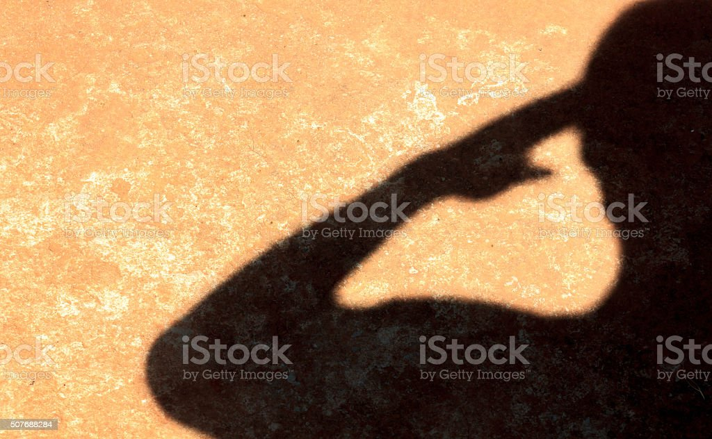 shadow sign human is saluting. stock photo