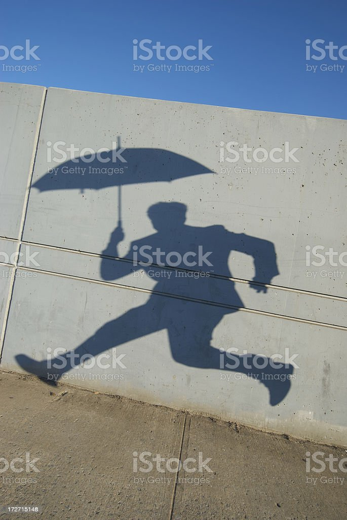 Shadow Umbrella Businessman Jumps on City Sidewalk royalty-free stock photo