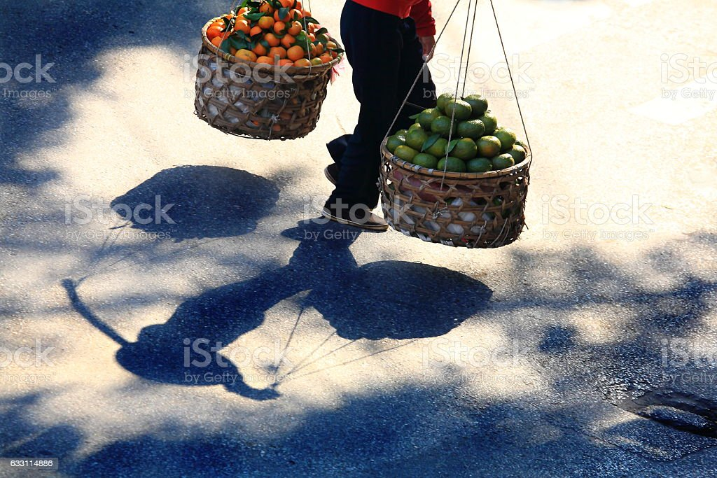 Shadow View Of Vietnamese Woman With Carrying stock photo