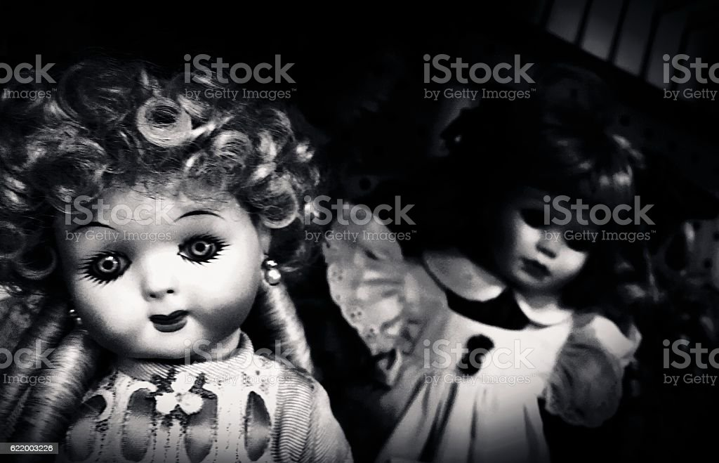 Shadowed Dolls stock photo