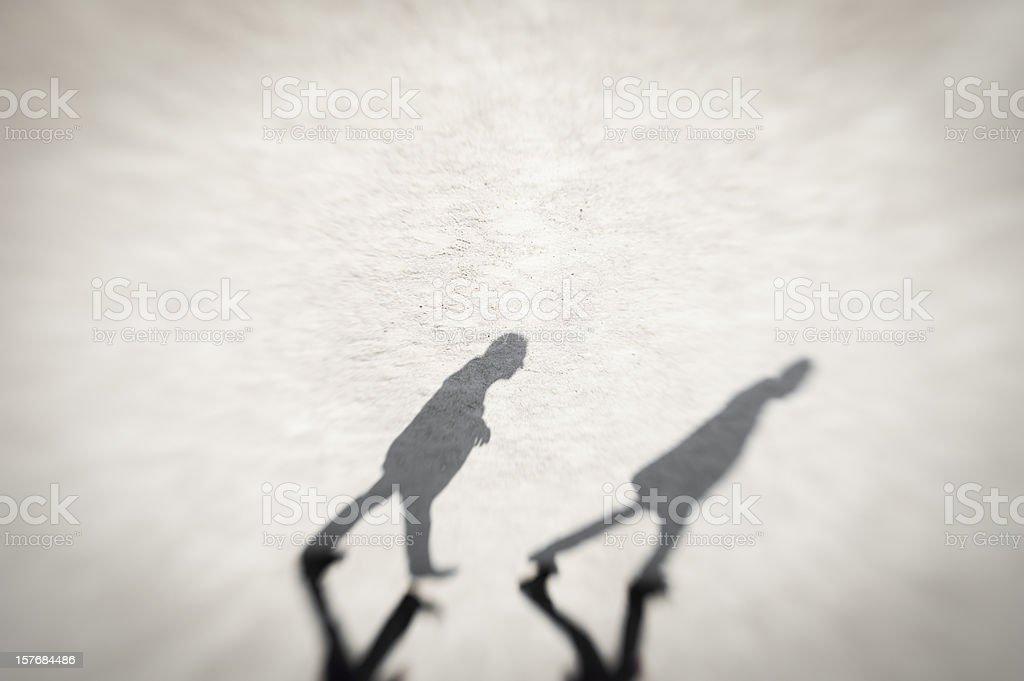 shadowed - followed stock photo