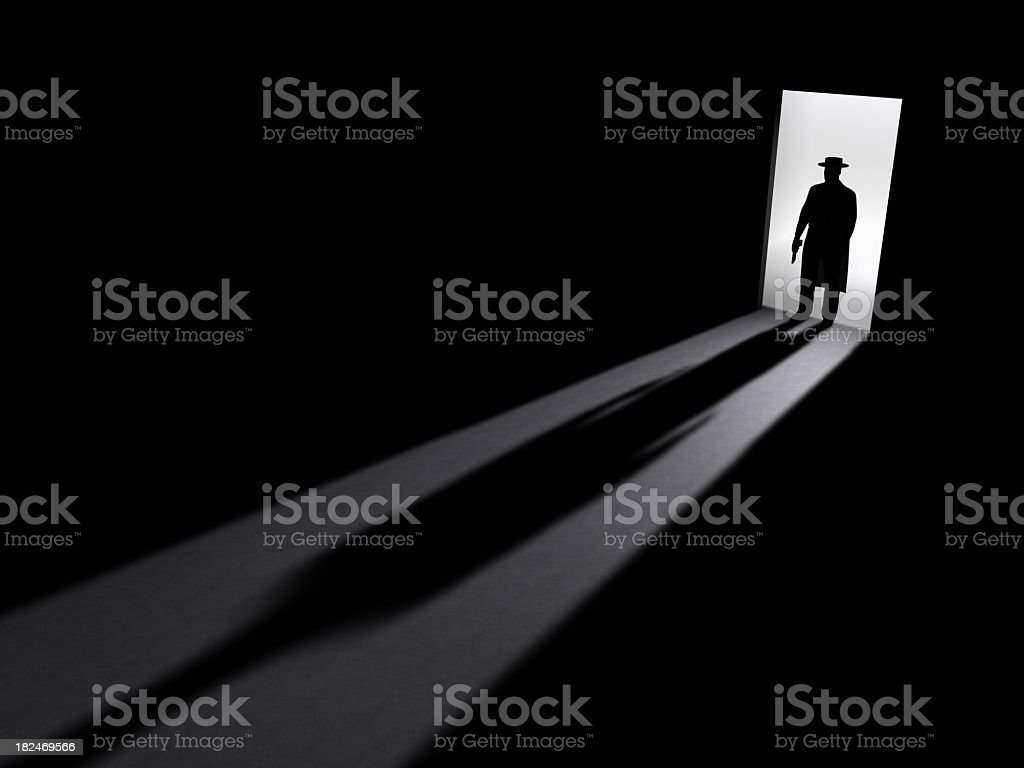 Shadowed image of an open door and person holding a gun stock photo