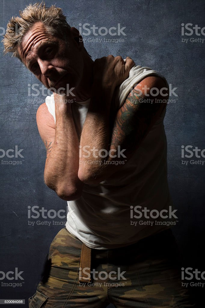 Shadowed Male Drug Addict With Tattoos stock photo