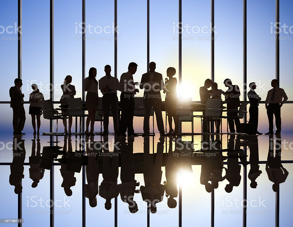Shadowed team of professionals against windows royalty-free stock photo
