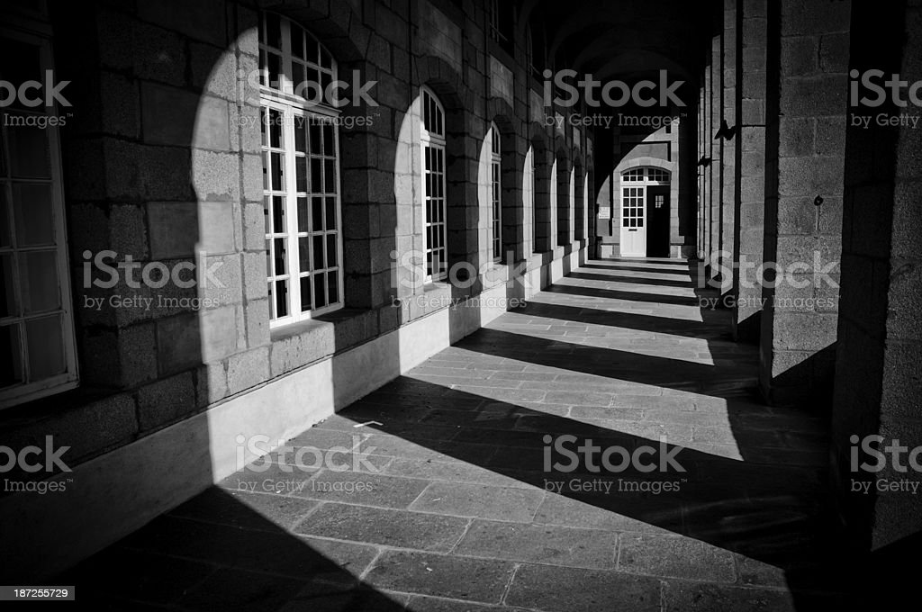 Shadows and columns in historical architecture stock photo