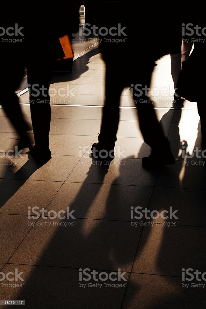 Shadows and Silhouettes of Commuters Walking to Work royalty-free stock photo
