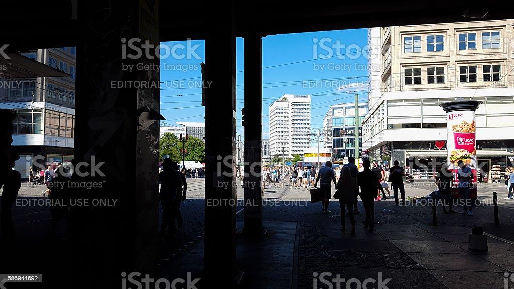shadows at Berlin Alexanderplatz - people under bridge stock photo