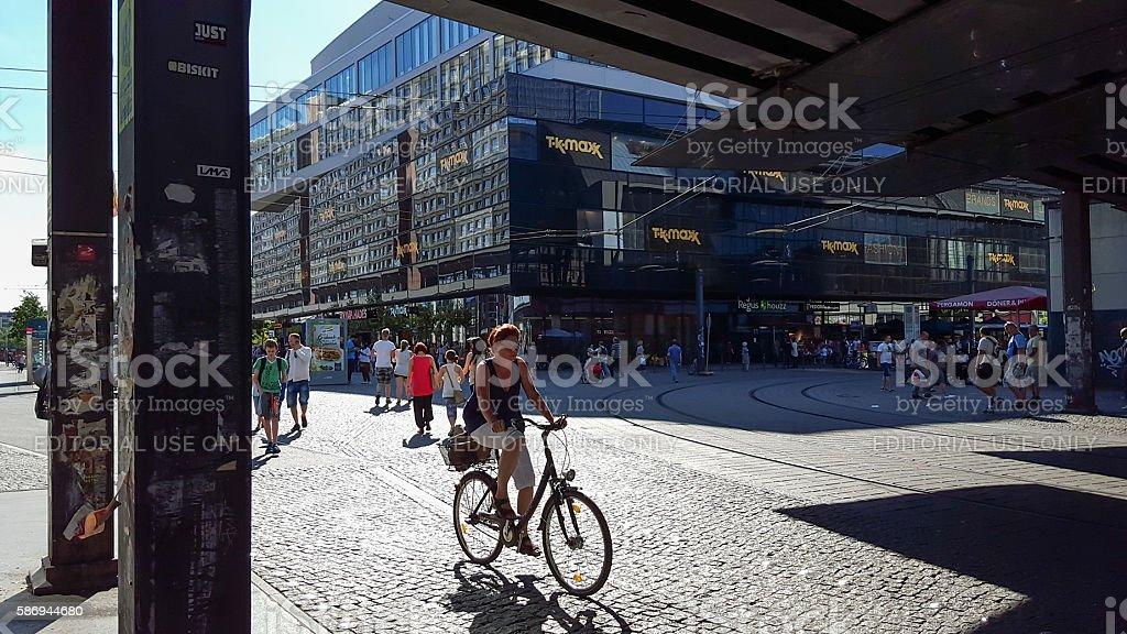 shadows at Berlin Alexanderplatz - woman on bicycle stock photo