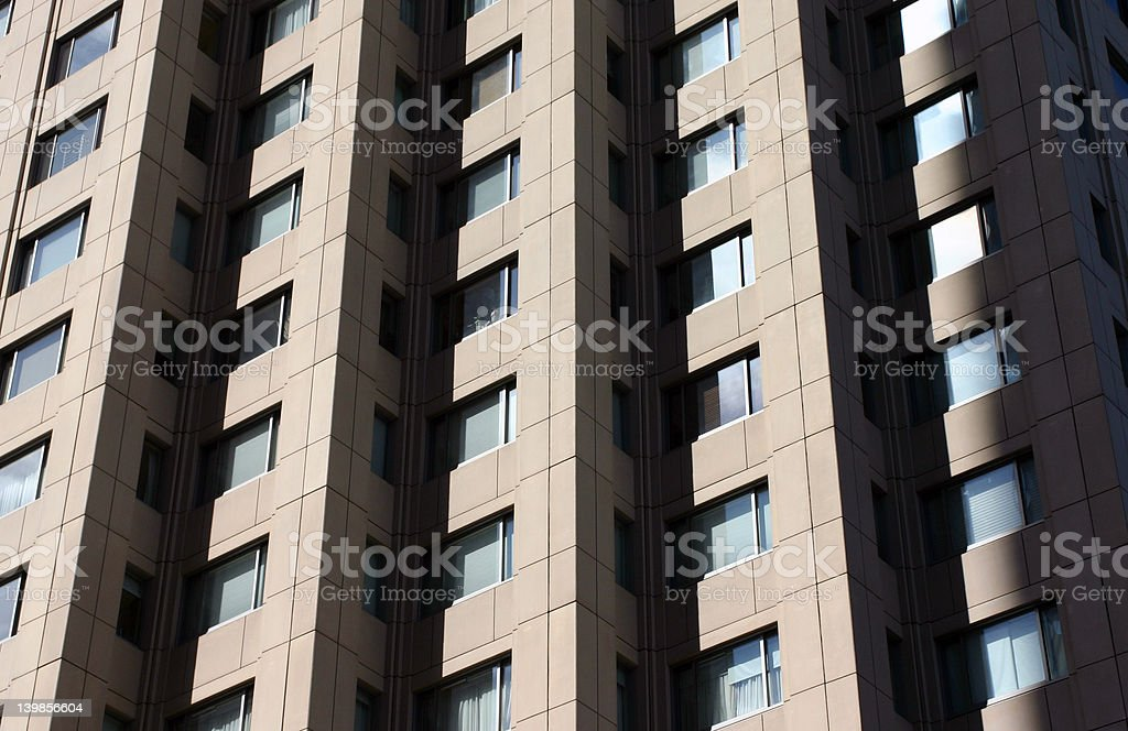 Shadows, Lines, and Windows of a Boston Apartment Building. stock photo