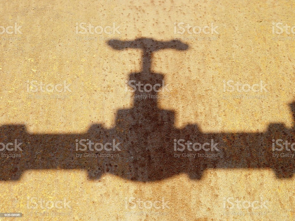 shadows of a rusted pipe royalty-free stock photo