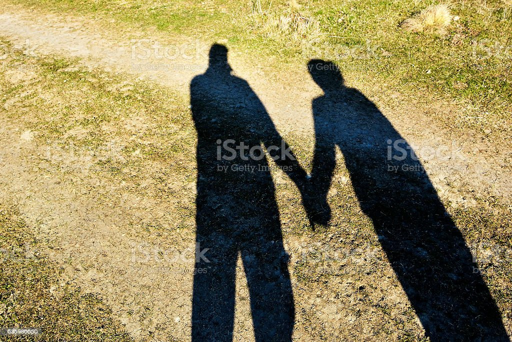 Shadows of couple in love on a walk. stock photo