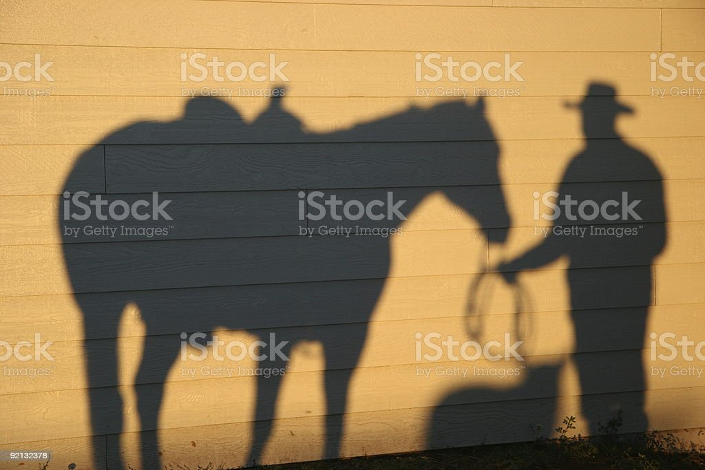Shadows of Dog , Horse and Cowboy stock photo