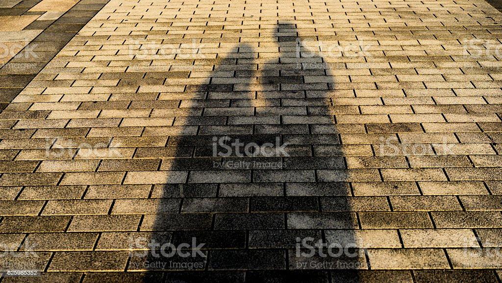Shadows of happy couple stock photo