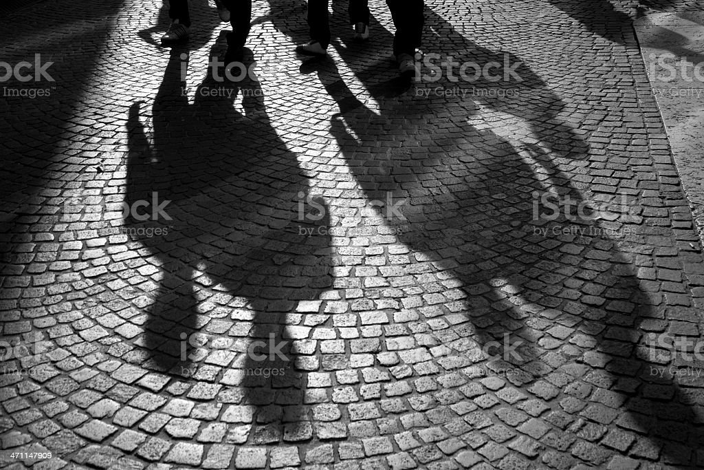 Shadows of passers-by royalty-free stock photo