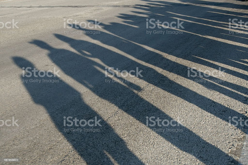 Shadows of People Lining a Morning Parade Route royalty-free stock photo