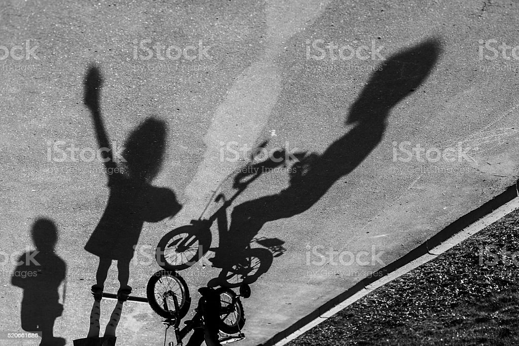 Shadows of playing children stock photo