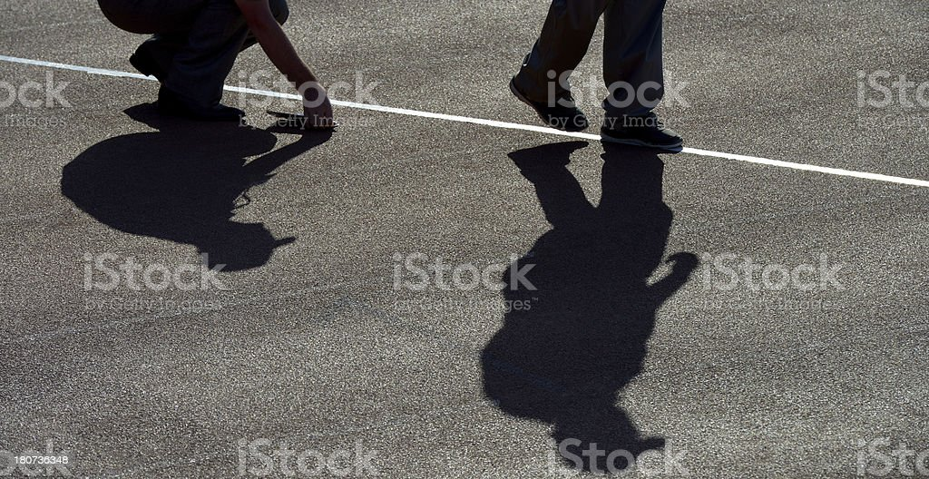 shadows of two men royalty-free stock photo