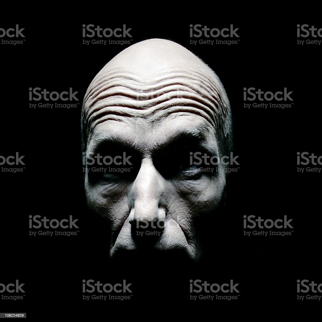 Shadows on Man's Face to form Skull royalty-free stock photo