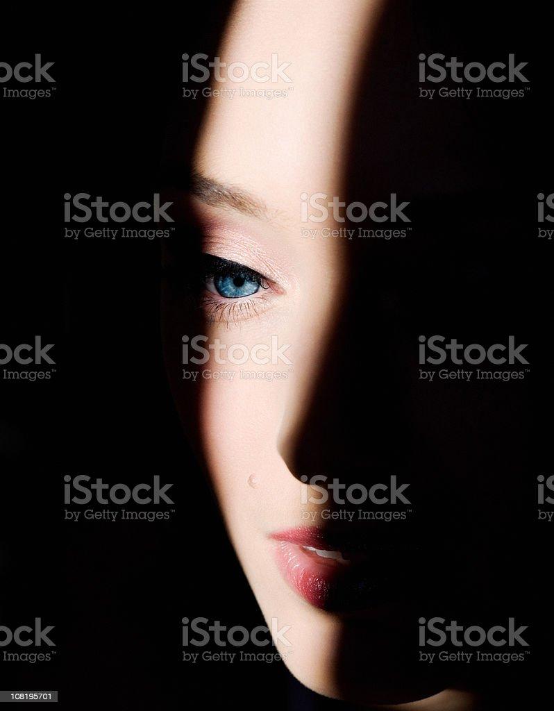 Shadows on Woman's Face stock photo