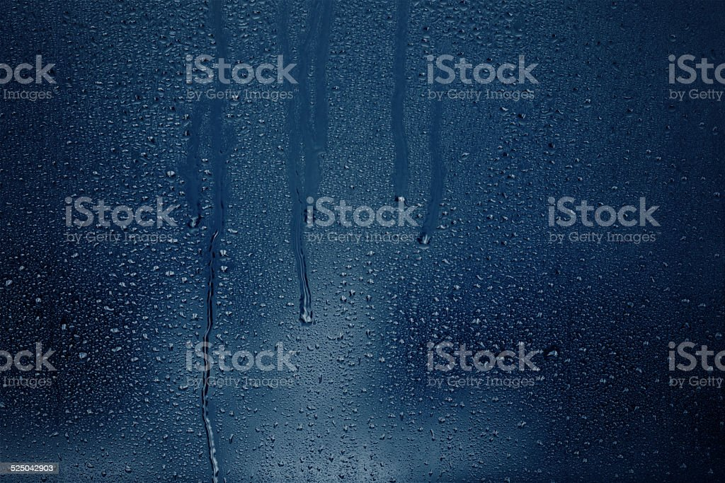 Shadowy condensation on a window stock photo