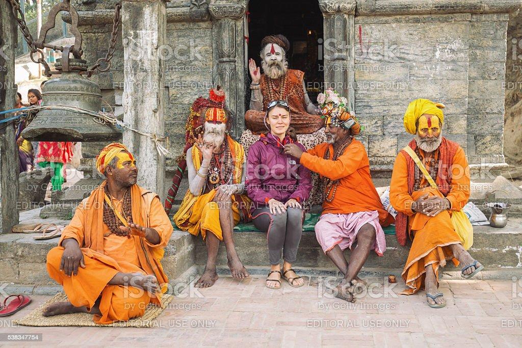 Shadu monks with tourist girl stock photo