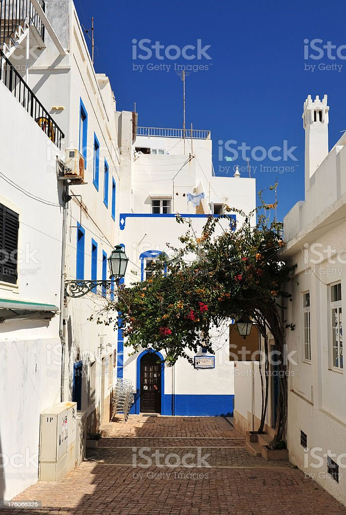 Shady backstreet in the Old Town of Albufeira, Algarve, Portugal stock photo