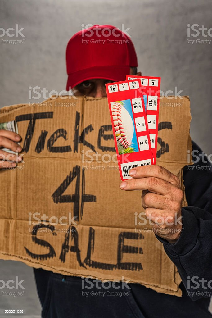 Shady character scapling a pair of baseball game tickets stock photo