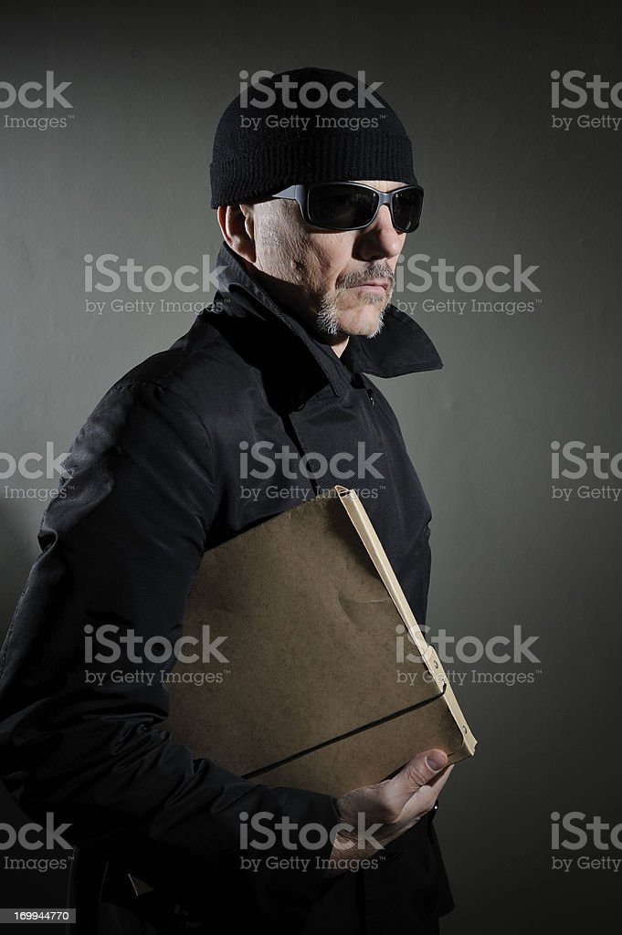 Shady Character With Secrets stock photo