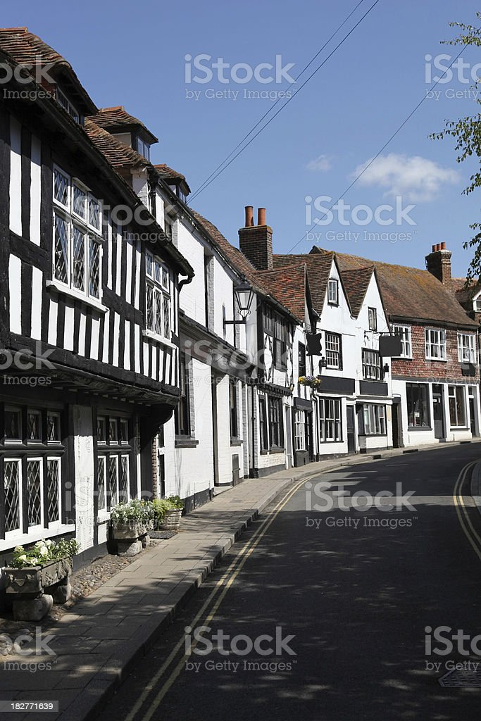Shady narrow street in Rye, East Sussex, England, UK royalty-free stock photo