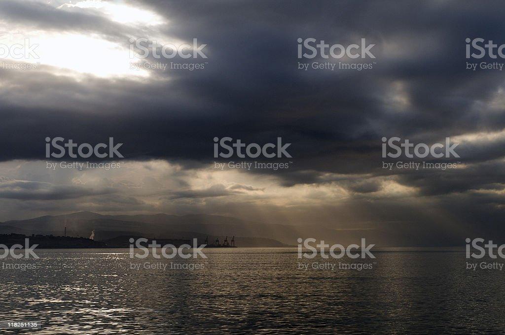 Shafts of sunlight through clouds over sea, Yalova, Turkey royalty-free stock photo
